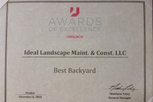 Photo of Ideal Landscaping award from Unilock for Best Backyard Design in the Northeast.