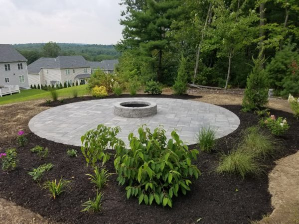 photo of a Round Patio and Fire pit-from Ideal Landscape Maintenance