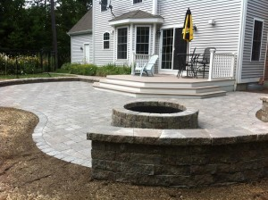 photo of a patio and fire pit built by Ideal Landscape