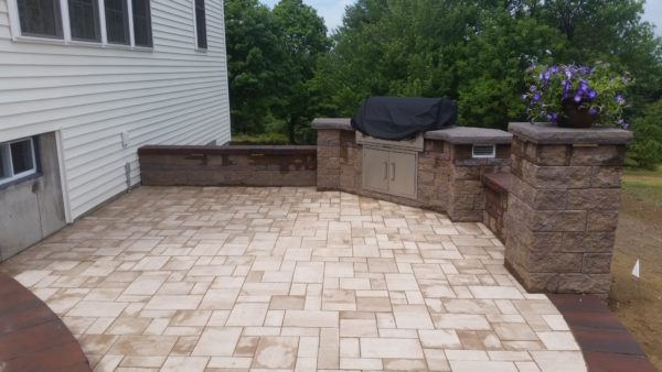 outdoor kitchen grilling area by Ideal Landscape of Holden MA