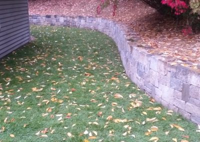 photo of a Block stone retaining wall by Ideal Landscape
