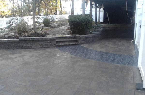 photo of a paver driveway and retaining wall built by Ideal Landscape of Holden MA