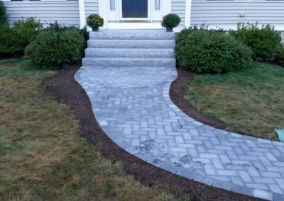 photo of Granite stairs and a paver walkway- Ideal Landscape