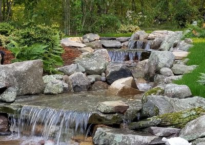 photo of Multiple waterfalls in a water feature- Ideal Landscape
