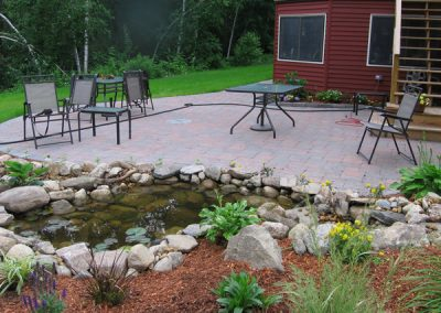Patio with a water feature- Ideal Landscape Holden MA