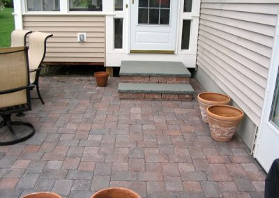 photo of Red Pavers and bluestone steps- installed by Ideal Landscape