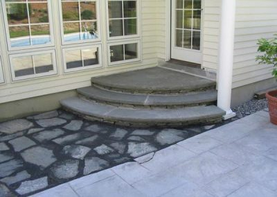 photo of Rounded stairs- bluestone and natural stone- installed by Ideal Landscape