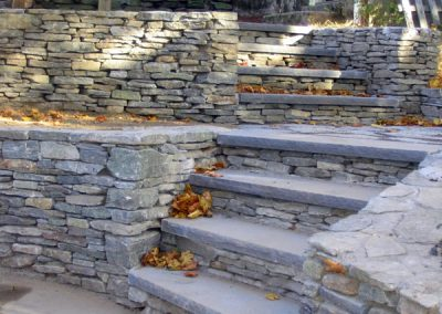 photo of Stone walls and granite stairs- Ideal Landscape