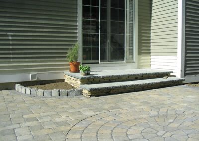 photo of granite and stone steps off a patio-Ideal Landscape