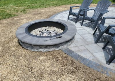 fire pit and round patio in Shrewsbury MA built by Ideal Landscaping