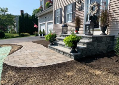 Stone stairs and paver walkway in Jefferson MA constructed by Ideal Landscape