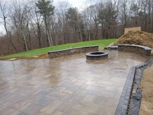 Top view of patio firepit and seating wall-Unilock